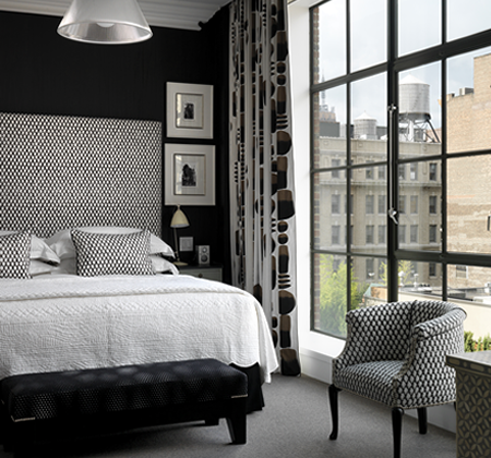 A one bedroom suite plays with the contrast of dark walls and light fabrics in the bedroom....